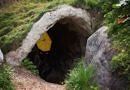 Cave with umbrella hiding in it with red evil eyes