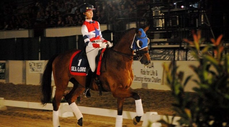 Sea Lord and Silva Martin dressage in racing silks