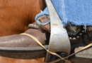 A Western rider's foot rubber banded to the stirrup.